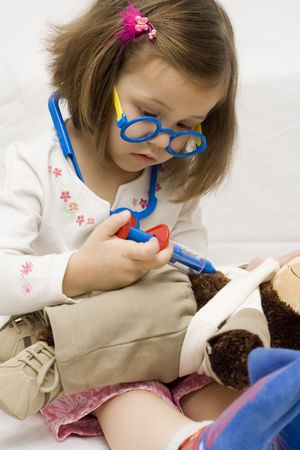 little doctor. 4 years old girl playing with doctor tools