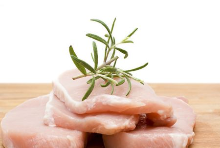 fresh meat on the board with rosemary Stock Photo - 2443103