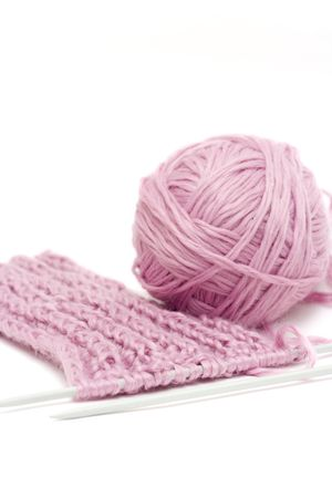 woolen cloth: bundle of violet wool and knitting needles Stock Photo