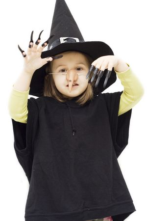the little girl wearing witch halloween costume