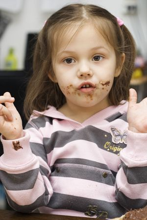 little girl with chocolate all over her face