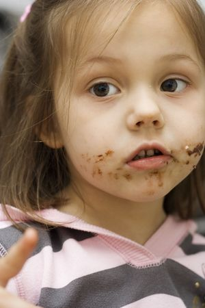 little girl with chocolate all over her face photo