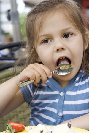 portrait of a little girl eating an ice cream