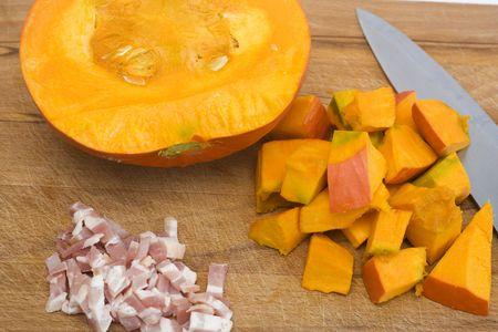 an orange pumpkin on board. soup ingredient. photo
