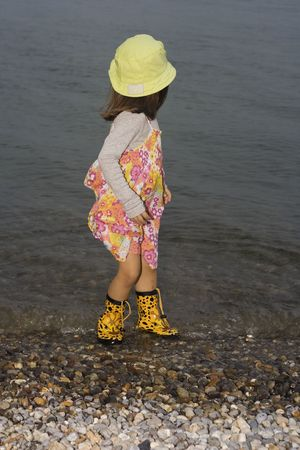 wellingtons: little girl wearing wellingtons playing in the lake Stock Photo