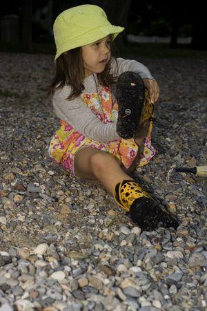 wellingtons: little girl wearing wellingtons playing on the beach