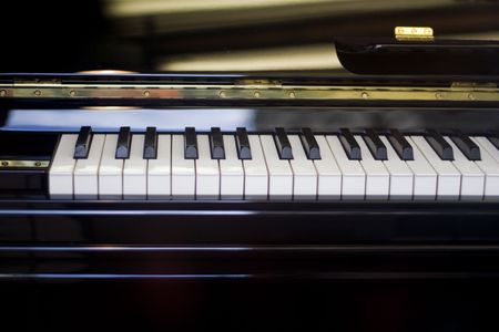 acoustically: close up of the piano - keypad. music.