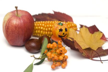 arrangement made of leaves, chestnuts and halloween candle photo
