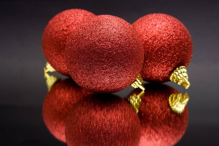 christmas decoration - ball against the black background photo