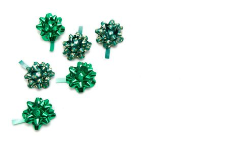 frame made of green bows isolated on white photo