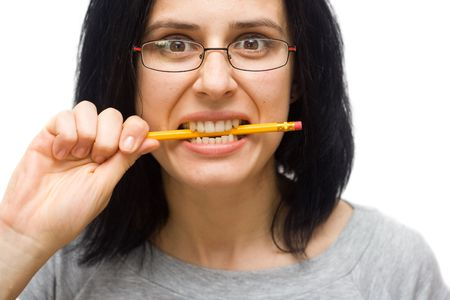 angry woman wearing glasses biting a pencil Stock Photo