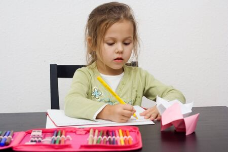 cute little girl drawing a picture on white Stock Photo - 3940684