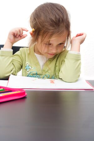 cute little girl drawing a picture on white Stock Photo - 3940691
