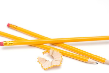 peeling rubber: yellow pencils with eraser isolated on white