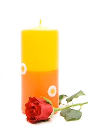 red rose with candle isolated on white photo