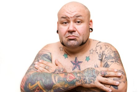 portrait of a bald man with tattoos Stock Photo