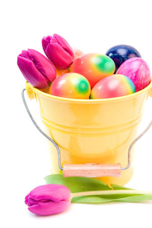 colorful easter eggs and purple tulips isolated on white photo