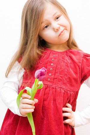 portrait of a 5 years old girl wearing a dress photo