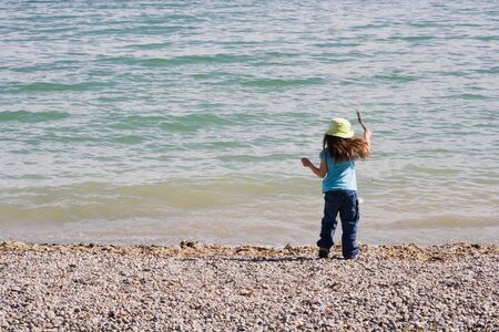 5 years old girl playing on the beach photo