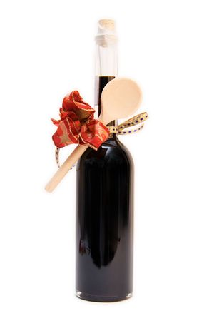 bottle of balsamic vinegar with wooden spoon