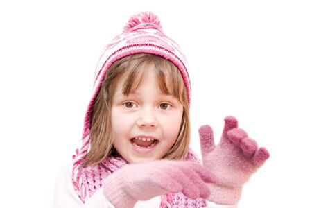 little girl wearing cap and gloves isolated on white Stock Photo - 5797453