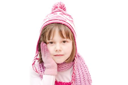 little girl wearing cap and gloves isolated on white photo
