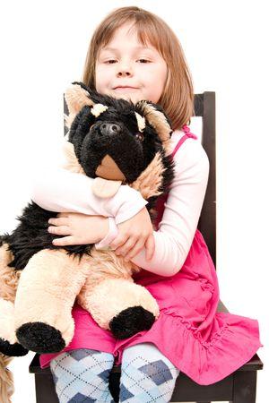 little girl hugging stuffed dog isolated on white photo