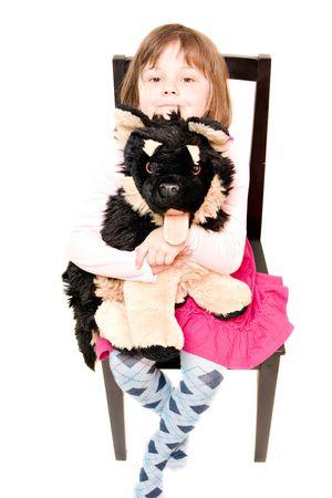 furry stuff: little girl hugging stuffed dog isolated on white Stock Photo