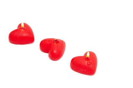 three red candles isolated on white. valentines day photo