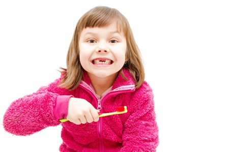 gap toothed girl brushing her teeth isolated on white Stock Photo