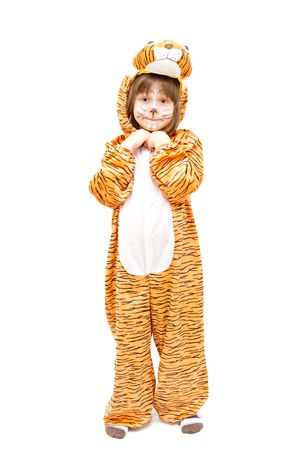 little girl wearing tiger costume isolated on white