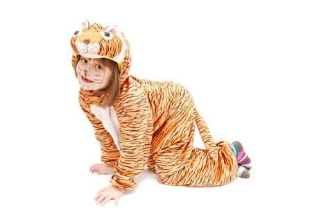 little girl wearing tiger costume isolated on white photo