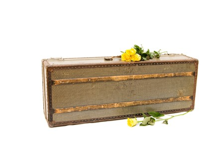 an old fashioned suitcase isolated on white photo