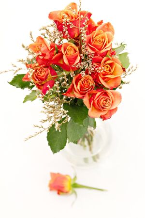 floral arrangement: bunch of orange roses isolated on white Stock Photo