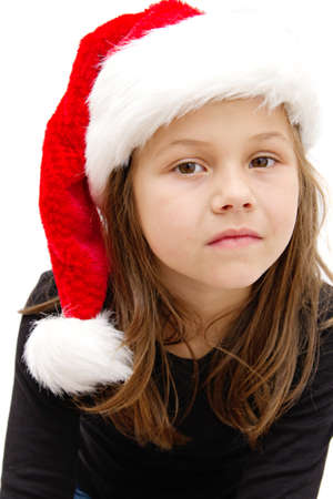 little girl dressed like a santa claus  photo