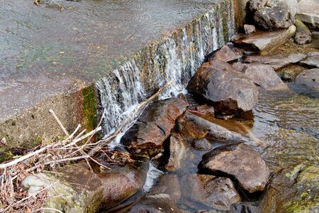 View on the river. Flowing water, stones and grass photo