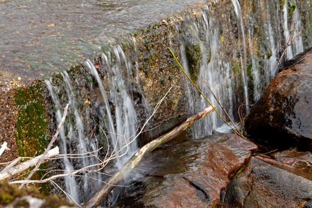 View on the river. Flowing water, stones and grass Stock Photo - 8808218