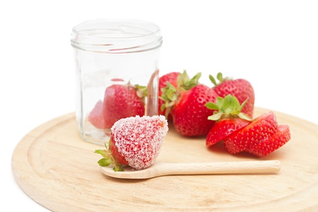 strawberries on a board isolated on white photo