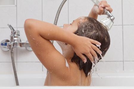 little girl bath: A little girl taking a bath on her own