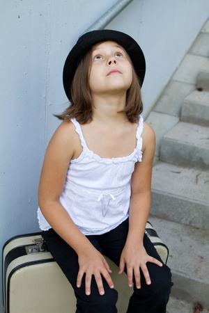 Lonely girl wearing a hat with suitcase  Stock Photo - 12171434