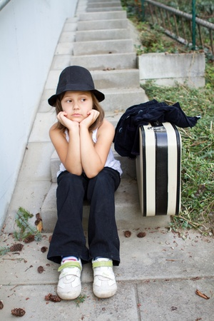 Lonely girl wearing a hat with suitcase  Stock Photo - 12659766