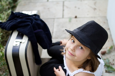 Lonely girl wearing a hat with suitcase  Stock Photo - 12659763
