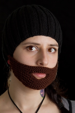 a woman wearin a fake beard Stock Photo - 12985505
