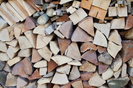 A stack made of chopped wooden logs Stock Photo - 12985507