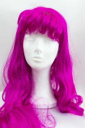 a funny pink wig on a white dummy