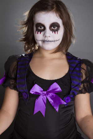 the girl wearing halloween make up photo