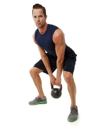 kettles: Young attractive male doing kettle bell cross fit exercise