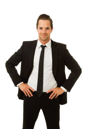hands on hips: Business man smiling with hands on hips  Isolated on white