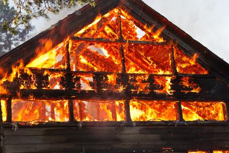 engulfed: House gable engulfed in flames Stock Photo