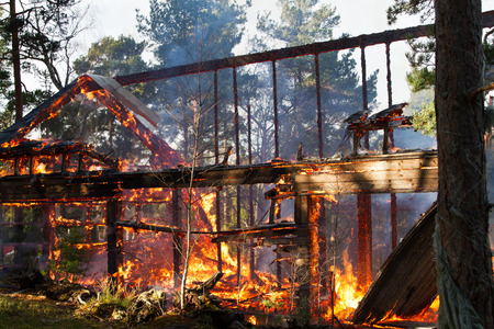 House ruin after fire, visible flames and glow Stock Photo - 37917281